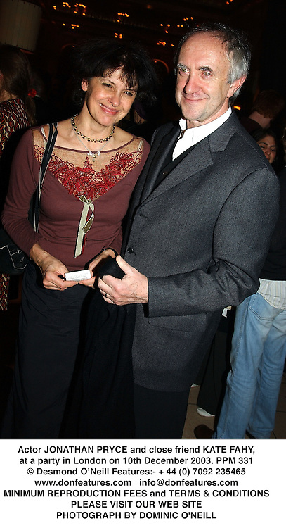 Actor JONATHAN PRYCE and close friend KATE FAHY, at a party in London on 10th December 2003.PPM 331
