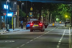 © Licensed to London News Pictures. 26/06/2020. London, UK. Two vehicles inside a cordon with medical kits on the foot path. A person has been stabbed on Du Cane Road in East Acton on Thursday 25th June 2020. A cordon closed off a large section of the road underneath a railway bridge where two vehicles remained. Photo credit: Peter Manning/LNP