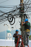 Communication workers install miles of wiring for the international media  across from Plaza Salvador Del Mundo (Savior of the World) El Salvador prepares for the beatification ceremony and mass announcing the beatification of Archbishop Oscar Romero. The Archbishop was slain at the alter of his Church of the Divine Providence by a right wing gunman in 1980. Oscar Arnulfo Romero y Galdamez became the fourth Archbishop of San Salvador, succeeding Luis Chavez, and spoke out against poverty, social injustice, assassinations and torture. Romero was assassinated while offering Mass on March 24, 1980.