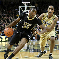Central Florida forward Keith Clanton (33) blows by forward Ron Anderson Jr. (1) during the NCAA basketball game against the USF Bulls at the UCF Arena on November 18, 2010 in Orlando, Florida. UCF won the game 65-59. (AP Photo/Alex Menendez)