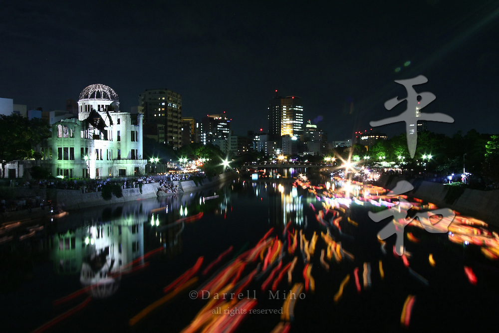 Aug 06, 2009; Hiroshima City, Hiroshima Pref., JPN - The Genbaku Dome is bathed in light during the lantern floating ceremony on the Motoyasu river in remembrance of those who have passed away from as a result of the atomic bombs. Photo credit: Darrell MIho.