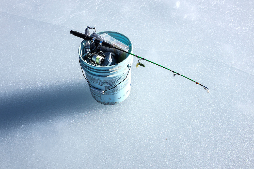 Fishing gear sits on the ice. Vallecito reservoir, Southwest Colorado.