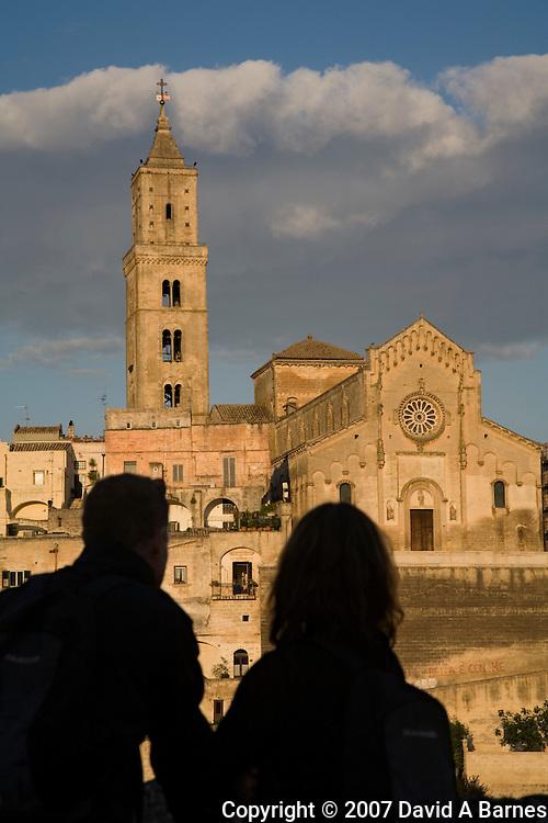 Couple looking at the Duomo, Sassi, Matera, Basilicata, Italy