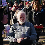 Speakers Peter Gardiner of 'Save the Square' at Occupy E17 Market Square demand for affordable homes + no land grab against greedy housing development to build a tower block it cost three time of  minimum wages to lives there. Protestors demand affordable housing and rent control of greedy landlord on 24 Feb 2018 in Walthamstow square, London, UK.