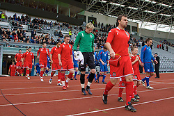 REYKJAVIK, ICELAND - Wednesday, May 28, 2008: Wales' new captain Carl Fletcher leads his side out to face Iceland during the international friendly match at the Laugardalsvollur Stadium. (Photo by David Rawcliffe/Propaganda)