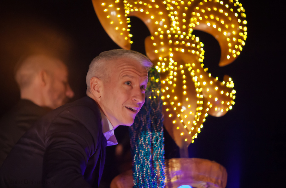 Anderson Cooper, the grand marshal  of Endymion rides on a float throwing beads and plastic cups during the parade that was put off by one day due to stormy weather during Mardi Gras 2011 celebrations.  Mardi Gras 2011 in New Orleans is expected to be have the largest attendance of all time due to the dates overlapping with college spring break. Mardi Gras also known as Carnival begins on or after Epiphany and ending on the day before Ash Wednesday.