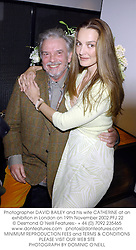 Photographer DAVID BAILEY and his wife CATHERINE at an exhibition in London on 19th November 2002.	PFJ 22