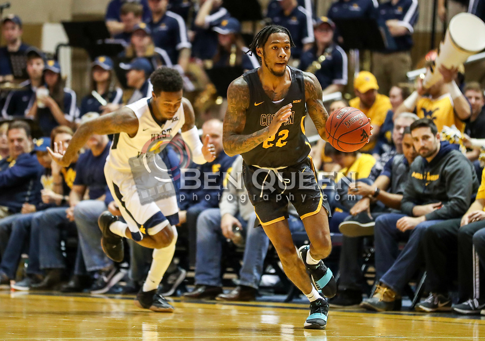 Dec 20, 2017; Morgantown, WV, USA; Coppin State Eagles guard Lamar Morgan (22) dribbles the ball up the floor during the first quarter against the West Virginia Mountaineers at WVU Coliseum. Mandatory Credit: Ben Queen-USA TODAY Sports