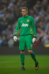 MANCHESTER, ENGLAND - Sunday, January 8, 2012: Manchester City's goalkeeper Anders Lindegaard in action against Manchester United during the FA Cup 3rd Round match at the City of Manchester Stadium. (Pic by David Rawcliffe/Propaganda)