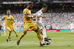 (l-r) Medhi Benatia of Juventus FC, Cristiano Ronaldo of Real Madrid during the UEFA Champions League quarter final match between Real Madrid and Juventus FC at the Santiago Bernabeu stadium on April 11, 2018 in Madrid, Spain