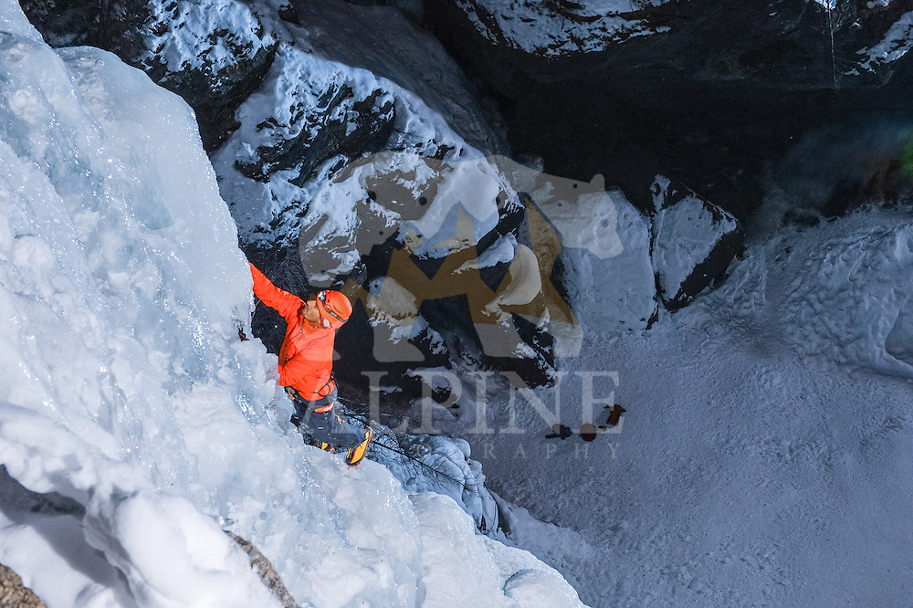 A top-view close-up perspective on Jeff Mercier, professional alpine climber, during a rapid night ascent of Cascatte di Lillaz icefall.