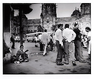 Passersby ignore man begging for change in front of neo-gothic Chhatrapati Shivaji Terminus (formerly Victoria Terminus), Mumbai, India.  The gap between rich and poor grows as India's middle class grows.