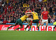 Two Australians were required to tackle Wales George North during the Rugby World CupPool A match between Australia and Wales at Twickenham, Richmond, United Kingdom on 10 October 2015. Photo by Matthew Redman.
