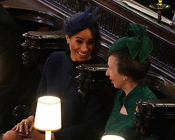 The Duchess of Sussex with the Princess Royal at the wedding of Princess Eugenie to Jack Brooksbank at St George's Chapel in Windsor Castle.