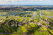 Nederland, Noord-Holland, Gemeente Oostzaan, 14-06-2012; polder Oostzaan, en in de voorgrond het lintdorp Oostzaan. Zaandam en autosnelweg A9 ophef tweede plan. De verkaveling in het gebied is het resultaat van veenontginning. .Polder and village Oostzaan, north of Amsterdam (at the horizon). The division in plots in the area is the result of peat extraction..luchtfoto (toeslag), aerial photo (additional fee required);.copyright foto/photo Siebe Swart