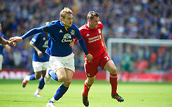 LONDON, ENGLAND - Saturday, April 14, 2012: Liverpool's Jamie Carragher and Everton's Nikica Jelavic during the FA Cup Semi-Final match at Wembley. (Pic by David Rawcliffe/Propaganda)