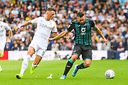 Leeds United defender Ben White (5) and Swansea City forward Borja Gonzalez (9) during the EFL Sky Bet Championship match between Leeds United and Swansea City at Elland Road, Leeds, England on 31 August 2019.