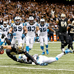 Dec 8, 2013; New Orleans, LA, USA; New Orleans Saints tight end Jimmy Graham (80) reaches over the goaline for a touchdown against the Carolina Panthers during the fourth quarter of a game at Mercedes-Benz Superdome. Mandatory Credit: Derick E. Hingle-USA TODAY Sports
