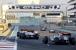 13.11.2011, Yas-Marina-Circuit, Abu Dhabi, UAE, Grosser Preis von Abu Dhabi, im Bild Sebastien Buemi (SUI), Scuderia Toro Rosso - Vitaly Petrov (RUS), Lotus Renault GP - Jaime Alguersuari (ESP), Scuderia Toro Rosso  // during the Formula One Championships 2011 Large price of Abu Dhabi held at the Yas-Marina-Circuit, 2011/11/13. EXPA Pictures © 2011, PhotoCredit: EXPA/ nph/ Dieter Mathis..***** ATTENTION - OUT OF GER, CRO *****