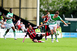 Bournemouth's Richard Hughes fouls Yeovil Town's Edward Upson - Photo mandatory by-line: Dougie Allward/Josephmeredith.com  - Tel: Mobile:07966 386802 08/09/2012 - SPORT - FOOTBALL - League 1 -  Yeovil  - Huish Park -  Yeovil Town v AFC Bournemouth