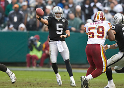 December 13, 2009; Oakland, CA, USA;  Oakland Raiders quarterback Bruce Gradkowski (5) during the first quarter against the Washington Redskins at Oakland-Alameda County Coliseum.  Washington defeated Oakland 34-13.