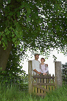 Couple embracing by gate in countryside