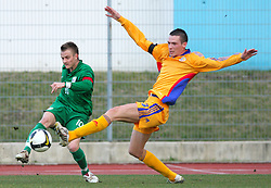 Rene Mihelic (10)  of Slovenia and Andei Cardos of Romania  during Friendly match between U-21 National teams of Slovenia and Romania, on February 11, 2009, in Nova Gorica, Slovenia. (Photo by Vid Ponikvar / Sportida)