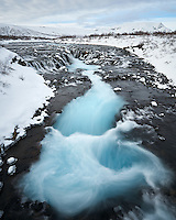 Brúarfoss waterfall in winter, South Iceland.
