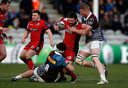 Edinburgh Rugby's Cornell Du Preez is challenged by Harlequins' Jack Clifford and George Merrick during the European Challenge Cup, pool five match at Twickenham Stoop, London.