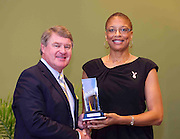 ACC Commissioner John D. Swofford presents former Florida State star Glenda Stokes-Pye with her Women's ACC Legends Award at the 2011 ACC Legends Banquette held at the Terrace Greensboro Coliseum Complex in Greensboro, North Carolina.  (Photo by Mark W. Sutton)