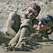 Ian Stewart/Yukon News<br /> Shayne Triggs and Tamara Lucas get muddy.