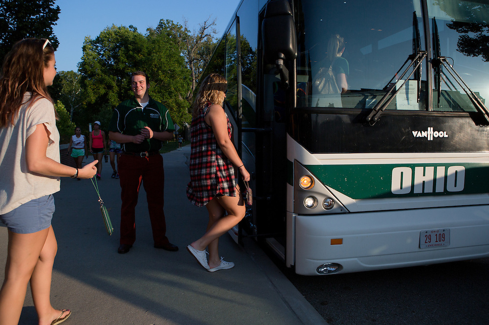 "Matt Thomson greets students as they board an Ohio University charter bus for the UPR ""How To Navigate Athens"" event on Aug. 26, 2014. The bus ride began with a trip to the Ridges and ended with a tour of campus. Photo by Lauren Pond"