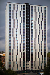 © Licensed to London News Pictures . 11/10/2018. Salford , UK . GV of Spruce Court with temporary cladding fitted on the bottom three floors and unsafe cladding remaining in place above . Recently installed cladding at several council-owned tower blocks in Salford has been identified as having similar dangerous properties to that which was installed on the Grenfell Tower in London . Residents have been waiting months for clarification on what action will be taken to make their homes safe . Photo credit : Joel Goodman/LNP