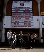 Group of young men in front of a multiplex.