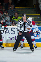 KELOWNA, CANADA - NOVEMBER 9: Kevin Crowell linesman blows the whistle on November 9, 2013 at Prospera Place in Kelowna, British Columbia, Canada.   (Photo by Marissa Baecker/Shoot the Breeze)  ***  Local Caption  ***