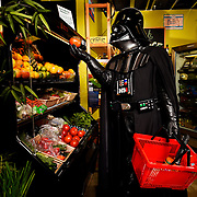 Brian Rehka playing the role of Darth Vader poses for a photograph Saturday, July 11, 2015 at Duckweed Urban Grocery in Tampa. CHRIS URSO/STAFF