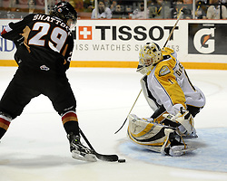 Tyler Shattock of the Calgary Hitmen shovels the puck past Brandon Wheat Kings' goalie Jacob De Serres in Game 6 of the 2010 MasterCard Memorial Cup in Brandon, MB on Wednesday May 19, 2010. Photo by Aaron Bell/CHL Images