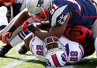 Buffalo Bills running back C.J. Spiller is elbowed in the nose while being tackled by New England Patriots linebacker Jerod Mayo after a 12-yard carry in the second quarter at Gillette Stadium in Foxboro, Massachusetts on November 11, 2012.  UPI/Matthew Healey