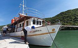 THEMENBILD - URLAUB IN KROATIEN, ein Bootsbesitzer vergrössert wegen EU Richtlinien den Schriftzug des Schiffsnamens im Limski Kanal, aufgenommen am 02.07.2014 in Porec, Kroatien // a boat owner enlarged the lettering of the ship's name due to EU directives in the Limski fjord at Vrsar, Croatia on 2014/07/02. EXPA Pictures © 2014, PhotoCredit: EXPA/ JFK