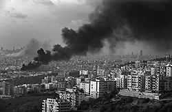 Israeli airstrikes fill the sky with smoke after the home of Hezbollah's Sheik Hassan Nasrallah and a fuel dump at the Rafik Hariri International Airport were targeted in Beirut, Lebanon on July 14 2006. <br /> Israel tightened its seal on Lebanon, blasting its air and road links to the outside world to punish the guerrilla group, and with it, the country for the capture of two Israeli soldiers.