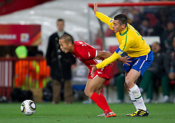 Korea's Jong Tae Se vs Brazil's Lucio during the 2010 FIFA World Cup South Africa Group G match between Brazil and North Korea at Ellis Park Stadium on June 15, 2010 in Johannesburg, South Africa.  (Photo by Vid Ponikvar / Sportida)