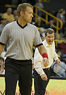 December 8, 2011: Iowa Hawkeyes head coach Tom Brands yells at the referee during the 133 pound bout of the NCAA wrestling dual between the Northern Iowa Panthers and the Iowa Hawkeyes at Carver-Hawkeye Arena in Iowa CIty, Iowa on Thursday, December 8, 2011. Ramos defeated Jauch 15-5 and Iowa defeated Northern Iowa 38-4.