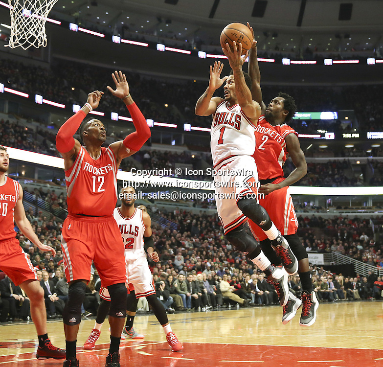 Jan. 5, 2015 - Chicago, IL, USA - Chicago Bulls guard Derrick Rose (1) goes to the basket against Houston Rockets center Dwight Howard (12) during the first half on Monday, Jan. 5, 2015, at the United Center in Chicago