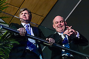 National's chief of staff Wayne Eagleson and senior minister Steven Joyce look over assembled supporters at the Viaduct Event Centre.  <br /> 2014 New Zealand General Election night photography commissioned by The NZ Listener magazine.