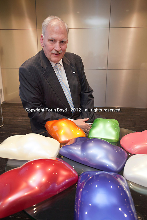 Tokyo, Japan, July 27, 2012: this is Dr. Karl Roeser, Representative Director, Chairman and President of Merck Ltd., Japan with pigment samples at his companies' head office in the Meguro district of Tokyo. Merck Ltd., Japan is the chemicals unit of Merck KGaA, Germany, one of the leading pharmaceutical and chemical manufacturers in the world. It was established in Japan in 1968 for marketing Merck Group products and it's current core businesses are liquid crystals, pigments and life science products. They also have two factories in Japan; one in Atsugi, Kanagawa Prefecture, the other in Iwaki, Fukushima  Prefecture (Photo by Torin Boyd).
