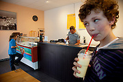 Lenard Sturm and his brother Malte Erik at an icecream shop near their apartment in Hamburg, Germany after school. They were photographed for the Hungry Planet: What I Eat project with a week's worth of food in June. Model Released.