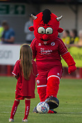 The Red Devil mascot with a young supporter prior to the EFL Cup match between Crawley Town and Norwich City at The People's Pension Stadium, Crawley, England on 27 August 2019.