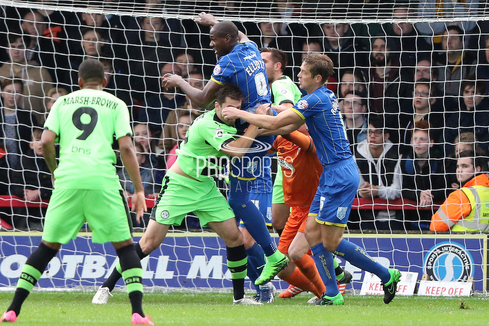 Tom Elliott of AFC Wimbledon clears another Forest green corner during the The FA Cup match between AFC Wimbledon and Forest Green Rovers at the Cherry Red Records Stadium, Kingston, England on 7 November 2015. Photo by Stuart Butcher.