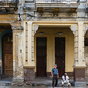 Two men on a street in Havana