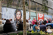 Londoners outside the Bosco shop soon to open on the opening day of the Westfield Stratford shopping mall. Situated on the fringe of the 2012 Olympic park, Westfield hosted its first day to thousands of shoppers eager to see Europe's largest urban shopping centre. The £1.45bn complex houses more than 300 shops, 70 restaurants, a 14-screen cinema, three hotels, a bowling alley and the UK's largest casino. It will provide the main access to the Olympic park for the 2012 Games and a central 'street' will give 75% of Olympic visitors access to the main stadium so retail space and so far 95% of the centre has been let. It is claimed that up to 8,500 permanent jobs will be created by the retail sector.
